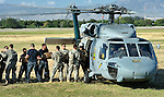 Military personnel from the United States load relief supplies on a U.S. Navy helicopter at the airport in Port-au-Prince, Haiti. The relief supplies, provided by governments and nongovernmental organizations including the ACT Alliance, were being transported to homeless families in Jacmel, on Haiti's southern coast, who survived their country's January 12 earthquake.