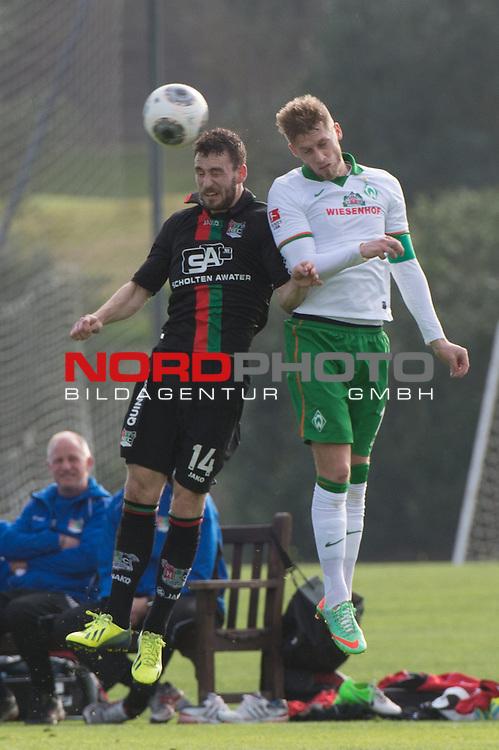 Trainingsgel&auml;nde, Jerez, ESP, 1.FBL, FSP  Werder Bremen (GER)  vs NEC Nijmegen (NED),  12.01.2014, <br /> <br /> Kevin Conboy (NEC #14)<br /> Aaron Hunt (Bremen #14)<br /> <br /> Foto &copy; nordphoto/ Kokenge