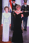 First lady Nancy Reagan poses for a photo with Princess Diana as she and United States President Ronald Reagan welcome Prince Charles and the Princess to the White House in Washington, DC for a dinner in honor of the royal couple on November 9, 1985.<br /> Credit: Howard L. Sachs / CNP