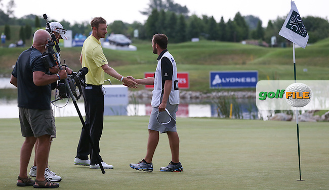 Caddie Mark Crane congratulates Chris Wood (ENG) as they complete the Final Round of the 2015 Lyoness Open powered by Greenfinity at the Diamond Country Club, Atzenbrugg, Vienna, Austria. 14/06/2015. Picture: Golffile | David Lloyd<br /> <br /> All photos usage must carry mandatory copyright credit (&copy; Golffile | David Lloyd)