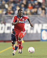 Chicago Fire midfielder Patrick Nyarko (14) brings the ball forward. In a Major League Soccer (MLS) match, the New England Revolution (blue) defeated Chicago Fire (red), 1-0, at Gillette Stadium on October 20, 2012.