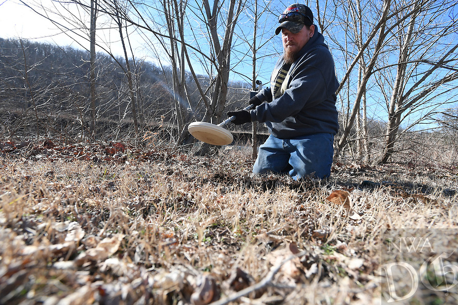 NWA Democrat-Gazette/J.T. WAMPLER M.D. Fillmore of Brentwood uses a metal detector Tuesday Jan. 8, 2019 to search for treasure at the Brentwood rest area. Fillmore and his wife Julia Fillmore found a valuable diamond ring recently in Murfreesboro on her first outing with the metal detector. Tuesday's efforts only yielded tin and a few nails.