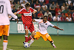 05 June 2009: Chicago's Brandon Prideaux (6) and Houston's Corey Ashe (26). The Houston Dynamo defeated the Chicago Fire 1-0 at Toyota Park in Bridgeview, Illinois in a regular season Major League Soccer game.
