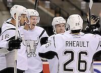 San Antonio Rampage players Andre Deveaux, from left, Alex Petrovic, John McFarland, and Jon Rheault celebrate a second period goal by Petrovic during an AHL hockey game against the Oklahoma City Barons, Sunday, Nov. 4, 2012, in San Antonio. (Darren Abate/pressphotointl.com)