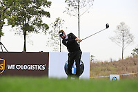 Matthew Baldwin (ENG) tees off the 14th tee during Sunday's Final Round of the 2014 BMW Masters held at Lake Malaren, Shanghai, China. 2nd November 2014.<br /> Picture: Eoin Clarke www.golffile.ie
