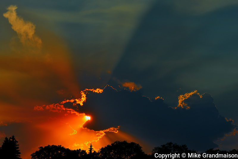 Crepuscular rays or God rays at sunset<br /> Winnipeg<br /> Manitoba<br /> Canada