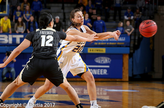 BROOKINGS, SD - MARCH 19:  Ena Viso #20 from South Dakota State passes the ball to a teammate around Ariana Freeman #12 from Colorado during their second round WNIT game at Frost Arena March 19, 2017 in Brookings, South Dakota. (Photo by Dave Eggen/Inertia)