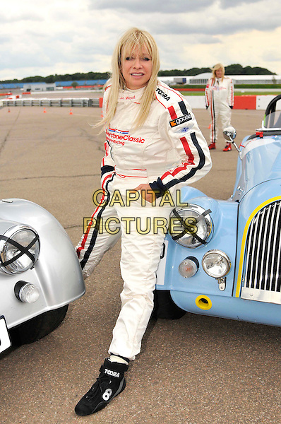 Jo Wood .At the Silverstone Classic Celebrity Race, Silverstone England, Silverstone, England, UK, July 23rd 2011..full length white cream racing suit red stripes .CAP/CAS.©Bob Cass/Capital Pictures.