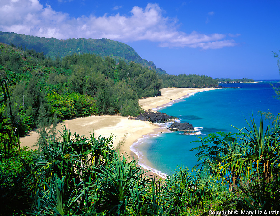 Kauai, HI          <br /> Secluded Lumahai Beach with its long white sand beach and blue waters stretches along the north shore of Kauai