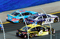 July 16, 2017 - Loudon, New Hampshire, U.S. - Chris Buescher, Monster Energy NASCAR Cup Series driver of the Liberty Tax Service Chevrolet (37), threads his car between Aric Almirola, driver of the Smithfield Ford (43), and Trevor Bayne, driver of the Performance Plus Motor Oil Ford (6), at  the NASCAR Monster Energy Overton's 301 race held at the New Hampshire Motor Speedway in Loudon, New Hampshire. Eric Canha/CSM