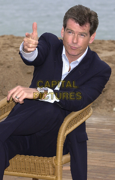 "PIERCE BROSNAN.Photocall to promote James Bond film ""Die Another Day"".Noga Hilton Beach, Cannes Film Festival, France,.18th May 2002..half length hand gesture.Ref: PL.www.capitalpictures.com.sales@capitalpictures.com.©Capital Pictures."