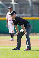 Umpire Skylar Shown handles the calls on the bases during the South Atlantic League game between the Augusta GreenJackets and the Hickory Crawdads at L.P. Frans Stadium on May 11, 2014 in Hickory, North Carolina.  The GreenJackets defeated the Crawdads 9-4.  (Brian Westerholt/Four Seam Images)