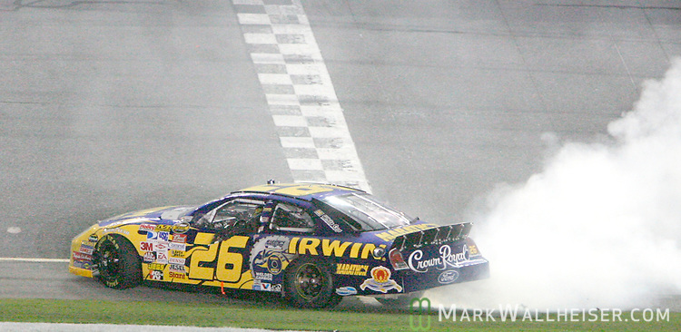 Jamie McMurray spins out at the finish line after he drove his number 26 Ford to win the Pepsi 400 NASCAR Nextel Cup Series race at the Daytona International Speedway in Daytona Beach, Florida July 7, 2007.  (Mark Wallheiser/TallahasseeStock.com)