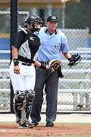 Home plate umpire Drew Maher and catcher Santiago Nessy #22 during a game between the GCL Blue Jays and GCL Tigers at the Englebert Complex on June 24, 2011 in Dunedin, Florida.  The Tigers defeated the Blue Jays 8-4.  (Mike Janes/Four Seam Images)