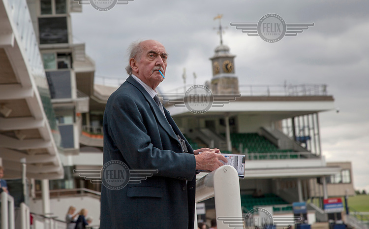 A man checking the form at Newmarket Races.