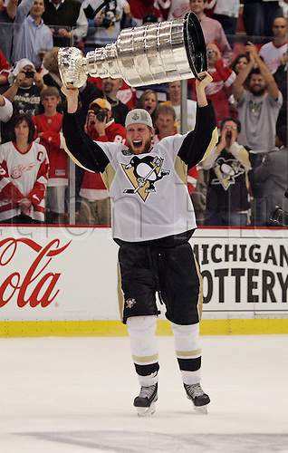 12 June 2009: Pittsburgh Penguins center Jordan Staal lifts the Stanley Cup Trophy on the ice after game seven of the NHL Stanley Cup Finals between the Pittsburgh Penguins and Detroit Red Wings, at Joe Louis Arena, in Detroit, Michigan. Pittsburgh won 2-1 to clinch the title.***** Editorial Use Only *****. UK Licenses only