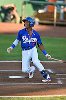 Errol Robinson (9) of the Ogden Raptors follows through on his swing against the Grand Junction Rockies during the Pioneer League game at Lindquist Field on August 25, 2016 in Ogden, Utah. The Rockies defeated the Raptors 12-3. (Stephen Smith/Four Seam Images)