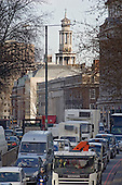 Traffic on the Euston Road, central London, and the spire of St.Pancras Church.