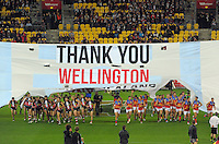 The teams run through a banner before the Australian Rules Football ANZAC Day match between St Kilda Saints and Brisbane Lions at Westpac Stadium, Wellington, New Zealand on Friday, 25 April 2014. Photo: Dave Lintott / lintottphoto.co.nz