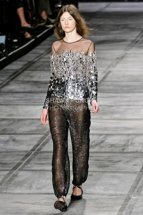 """Jacquelyn Jablonski walks Isaac Mizrahi Fall 2010 """"Central Park Story Book"""" runway show in City Lights, during the Mercedes-Benz Fashion Week Fall 2010."""
