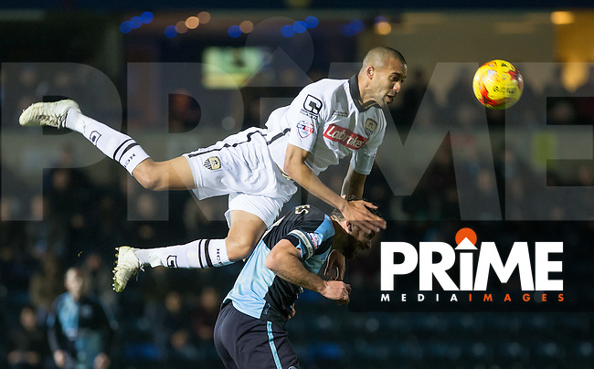 Thierry Audel of Notts County climbs on Paul Hayes of Wycombe Wanderers to make a clearance during the Sky Bet League 2 match between Wycombe Wanderers and Notts County at Adams Park, High Wycombe, England on 15 December 2015. Photo by Andy Rowland.