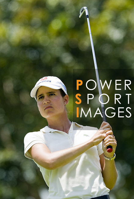 SINGAPORE - MARCH 06:  Lorena Ochoa of Mexico wathes her shot during the second round of HSBC Women's Champions at the Tanah Merah Country Club on March 6, 2009 in Singapore.  Photo by Victor Fraile / The Power of Sport Images