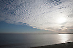 A mackerel sky or buttermilk sky of altocumulus clouds over Shingle Street, Suffolk, England