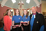 Mouswald School Closure last two pupils at Ruthwell Church, Head teacher Karen Bryden with pupils Eve Shrimpton and Lara Reid, the minister of Ruthwell Church Gerald Mole
