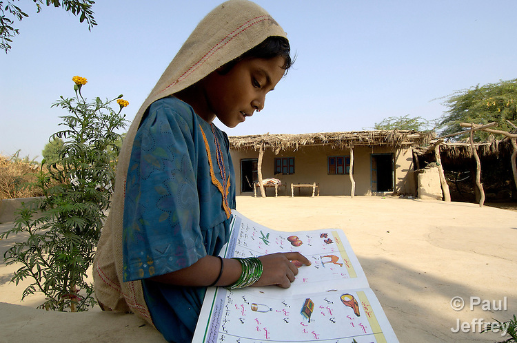 A girl studies her reading lesson in her village outside Mirpurkhas, Pakistan. With help from the Lower Sindh River Development Association (LSRDA), her family is working their own fields, free of the landlords' control for the first time, and she is going to school. LSRDA has worked throughout the area providing education, credit, and empowerment to vulnerable groups often living in virtual slavery to large landowners.