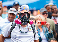 Mar 16, 2019; Gainesville, FL, USA; NHRA fan wears a gas mask in the pits during qualifying for the Gatornationals at Gainesville Raceway. Mandatory Credit: Mark J. Rebilas-USA TODAY Sports
