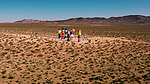 """Pictured: Visitors are dwarfed by brightly coloured sculptures comprising of stones that punctuate the stark, dry landscape of the Mojave desert in Nevada, USA. <br /> <br /> The unusual but striking shots were taken by Las Vegas native Henry Do, and are located 30 minutes from the main strip. <br /> <br /> The 7 columns form the outdoor installation, entitled 'Seven Magic Mountains' constructed by artist Ugo Rondinone. <br />  <br /> With each of the columns standing at over 35 feet tall, they signify """"the creative expression of human presence in the desert"""" and boldly exhibits a """"poetic burst of form and color.""""<br /> <br /> The 32 year-old commented on his photographs, saying """"The unique and bold colors in the middle of the desert is a truly breathtaking sight, and the rocks are enormous to stand beneath!""""<br /> <br /> Please byline: Henry Do/Solent News<br /> <br /> © Henry Do/Solent News & Photo Agency<br /> UK +44 (0) 2380 458800"""