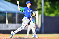 Lexington Legends starting pitcher Charlie Neuweiler (31) attempts a pickoff during a game against the Asheville Tourists at McCormick Field on July 1, 2019 in Asheville, North Carolina. The Tourists defeated the Legends 9-8. (Tony Farlow/Four Seam Images)