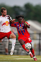 New York Red Bulls defender Kevin Goldthwaite (2) challenges Crystal Palace forward Gary Brooks (30) for the ball. Crystal Palace FC USA of Baltimore (USL2) defeated the New York Red Bulls (MLS) 2-0 during a Lamar Hunt US Open Cup third round match at Lawrence E. Knight Stadium in Annapolis, Maryland, on July 01, 2008.
