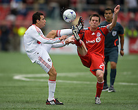 16 May 09: Chicago Fire midfielder Marco Pappa #16 and Toronto FC midfielder Sam Cronin #2 both go for the ball at BMO Field during a game between the Chicago Fire and Toronto FC..Chicago Fire won 2-0..