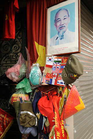 Asia, Vietnam, Hanoi. Shop with framed Ho Chi Minh portrait.