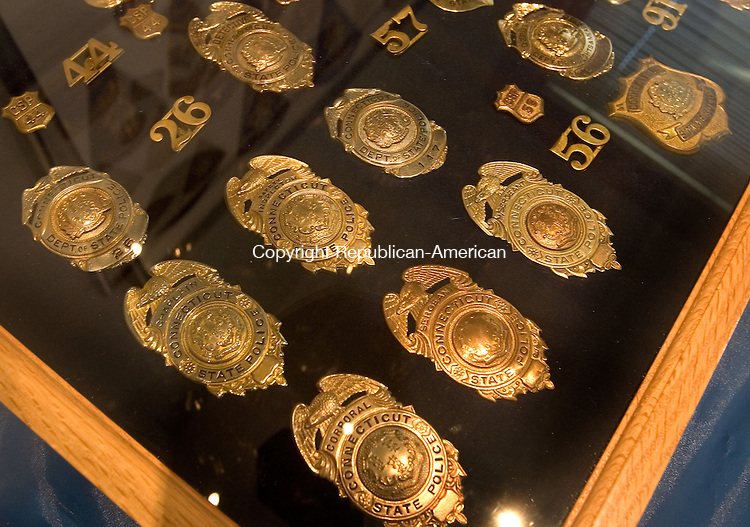 MERIDEN, CT. 11 November 2011-111111SV06--Old State Police badges on display the new State police Museum in Meriden Friday.<br /> Steven Valenti Republican-American