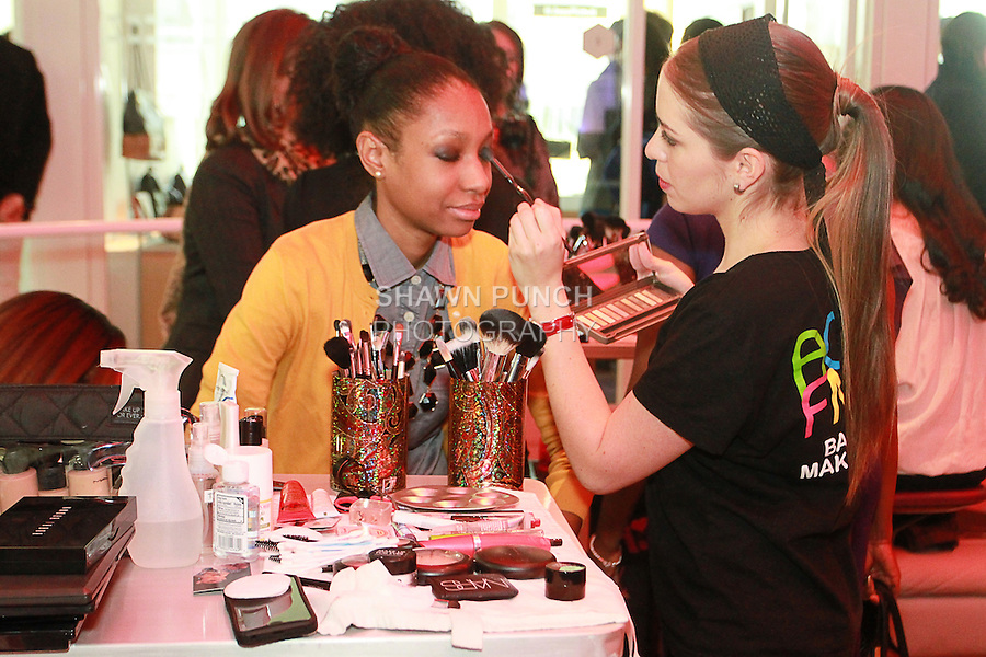 Woman gets her make styled by AOFM member at the Nolcha Fashion Lounge + Media Brunch event at the Yotel Hotel, during Nolcha Fashion Week New York Fall 2013, February 14, 2013.