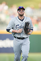 Columbus Clippers center fielder Tyler Holt (15) jogs off the field between innings of the game against the Charlotte Knights at BB&T BallPark on May 27, 2015 in Charlotte, North Carolina.  The Clippers defeated the Knights 9-3.  (Brian Westerholt/Four Seam Images)