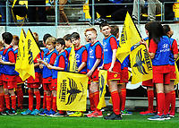 Flagbearers before the A-League football match between Wellington Phoenix and Adelaide United FC at Westpac Stadium in Wellington, New Zealand on Sunday, 8 October 2017. Photo: Dave Lintott / lintottphoto.co.nz