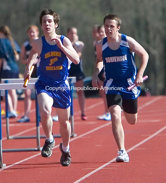 WOODBURY, CT- 23 APRIL 07- 042307JT09-<br /> Gilbert's Noah Pierce runs ahead of Nonnewaug's Mike ???????? (waiting for AD to call) during the boys' 4 X 800 meter event at Tuesday's track meet at Nonnewaug, which also hosted Thomaston.<br /> Josalee Thrift Republican-American