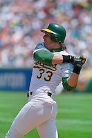 OAKLAND, CA - Jose Canseco of the Oakland Athletics bats during a game at the Oakland Coliseum in Oakland, California in 1992. Photo by Brad Mangin