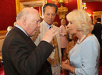 12 July 2016 - London, England - Camilla, Duchess of Cornwall, shares a joke with Richard E Grant, Julian Fellowes and Miriam Margolyes as she hosts the 30th Anniversary Garden Party for the National Osteoporosis Society in St James Palace in London. Due to inclement weather the event was moved indoors. The Duchess of Cornwall has been connected with the charity for nearly 30 years. Photo Credit: ALPR/AdMedia
