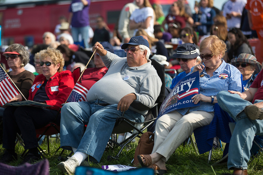 Supporters of Hillary Clinton listen as she speaks at Iowa Senator Tom Harken'a  annual Steak Fry in Indianola,  Iowa