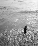 SRI LANKA, Asia, Colombo, high angle view of a boy standing in the Indian Ocean at Colombo (B&W)