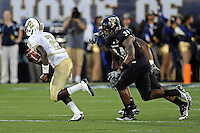 17 September 2011:  FIU linebacker Winston Fraser (34) pursues UCF quarterback Jeff Godfrey (2) in the second quarter as the FIU Golden Panthers defeated the University of Central Florida Golden Knights, 17-10, at FIU Stadium in Miami, Florida.