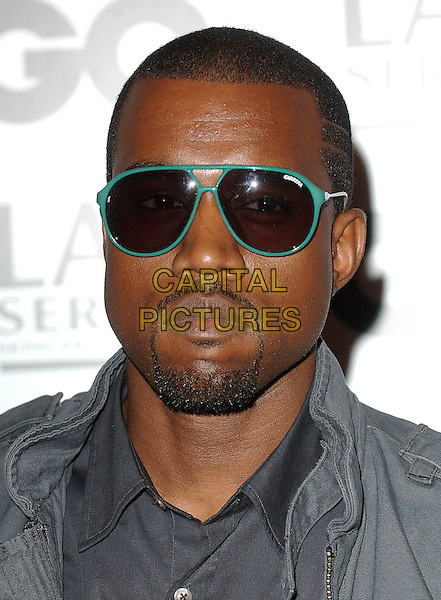 KANYE WEST.The GQ Man Of The Year Awards 2007, Royal Opera House, London, England..September 4th, 2007.headshot portrait sunglasses shades goatee facial hair.CAP/ BEL.©Tom Belcher/Capital Pictures.