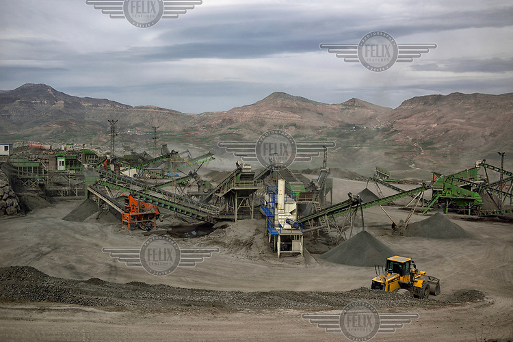 Construction machines at the site of the Ilusu hydroelectric dam. Most of the inhabitants of the village of Ilusu have already moved to a new settlement, as once the dam is complete the village will sit beneath a reservoir approximately of 313 km2 (121 sq mi).