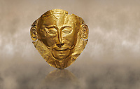 Mycenaean gold death mask, Mask of Agamemnon, Grave Cicle A, Mycenae, Greece.National Archaeological Museum of Athens. <br /> <br /> The mask from Grave V depicts an imposing face of a bearded man descovered by  Heinrich Schliemann who believed it was the body of Agamemnon, this is unproven to date.  The Mycenaean death mask belonged to a warrior and made of gold leaf it cocered the dead mans face held on by cord threaded tgrough the two sides of the mask.  The mask of Agamemnon was created from a single thick gold sheet, heated and hammered against a wooden background with the details chased on later with a sharp tool. The artifact dates from the 16th century BC.
