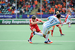 The Hague, Netherlands, June 15: Simon Mantell #8 of England tries to block a shot of Pedro Ibarra #5 of Argentina during the field hockey bronze match (Men) between Argentina and England on June 15, 2014 during the World Cup 2014 at Kyocera Stadium in The Hague, Netherlands. Final score 2-0 (0-0)  (Photo by Dirk Markgraf / www.265-images.com) *** Local caption ***