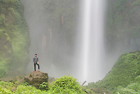 Local Indonesian tourist at 120m Sipisopiso Waterfall, Lake Toba (Danau Toba), North Sumatra, Indonesia